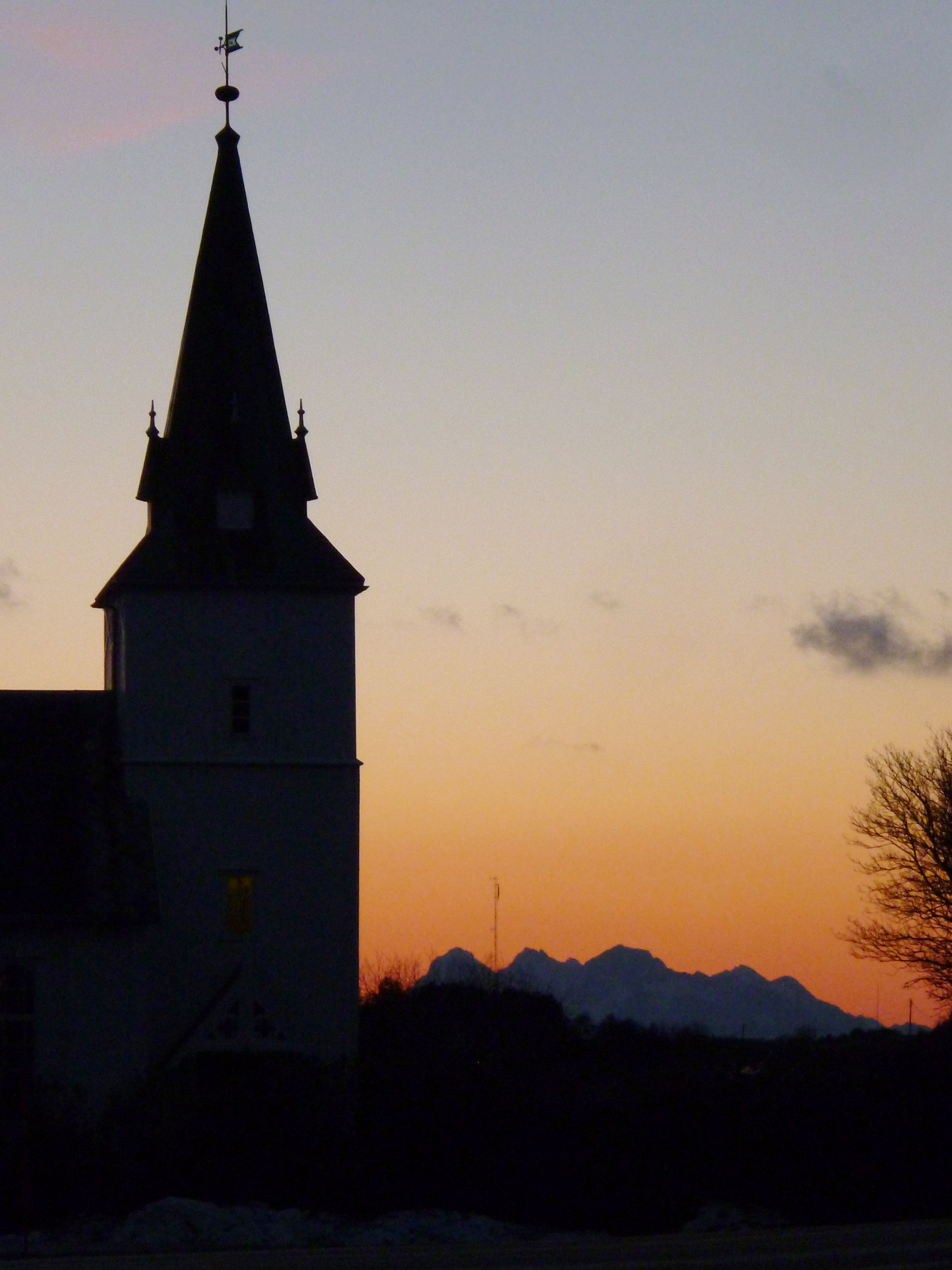 "As the ""day"" goes over into full night again, at about two o' clock in the afternoon, I snapped this picture of the church and the fading glow over the mountains."